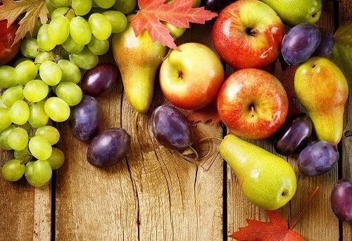 Organic Fruits over wood background. Autumn harvest