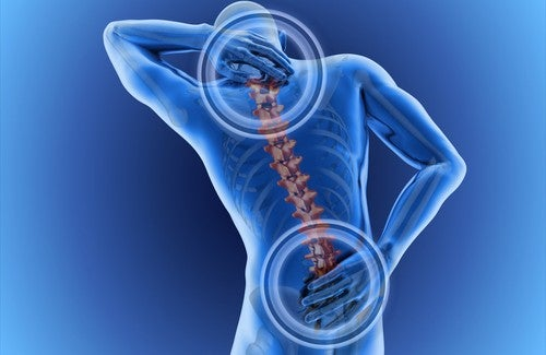 man experiencing symptoms of a herniated disc
