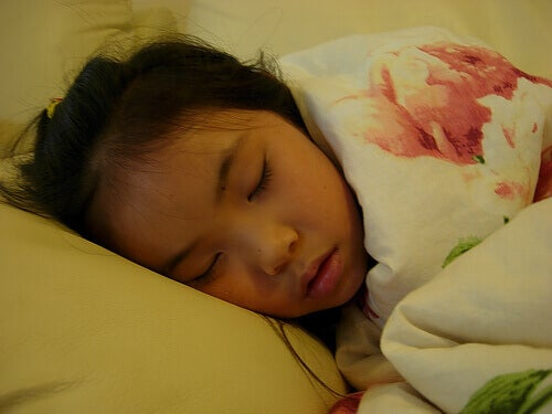 Girl sleeping due to fever