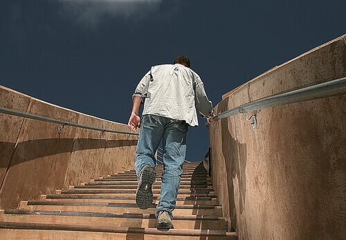 Man walking up outdoor stairs despite joint wear and tear