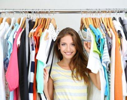 woman surrounded by comfortable clothes