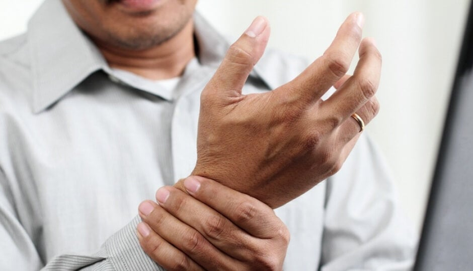 Man suffering with arthritis pain