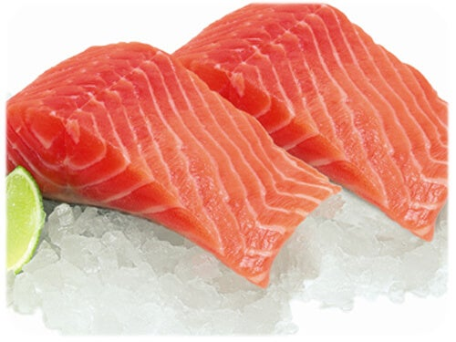 Two pieces of salmon on ice.
