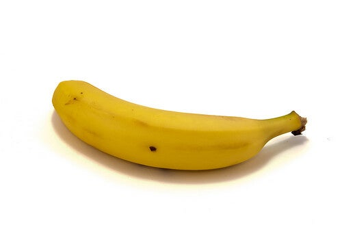 A single banana on a white background.