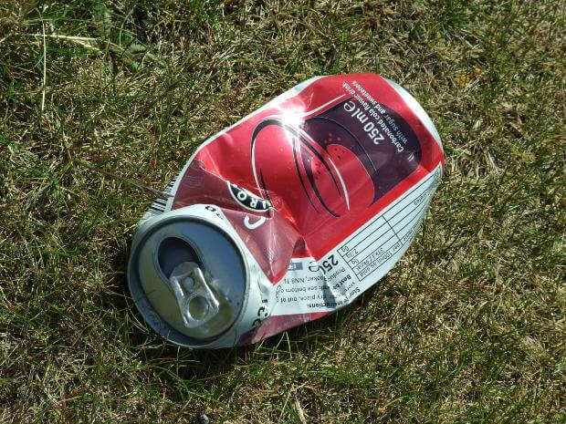 Crumpled can on ground