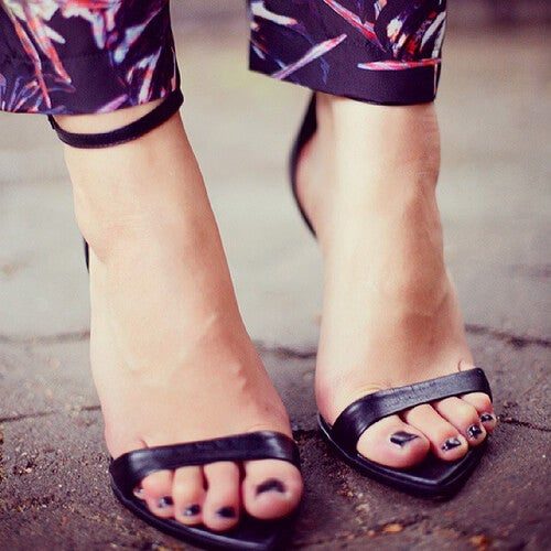 A woman wearing heels.
