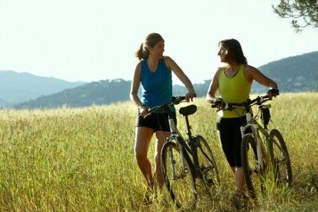 Two women exercising outside bikes awake all night