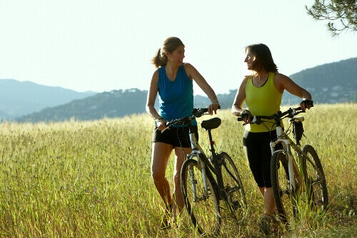 Two women exercising outside bikes awake all night