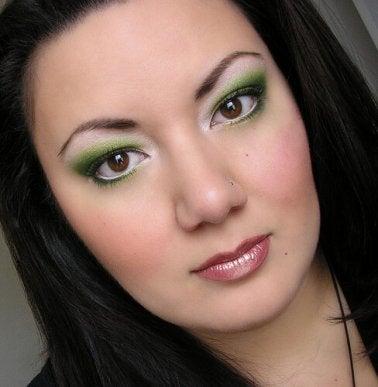 Woman with green eye makeup awake all night