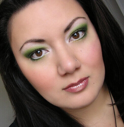 Woman with green eye makeup awake all night