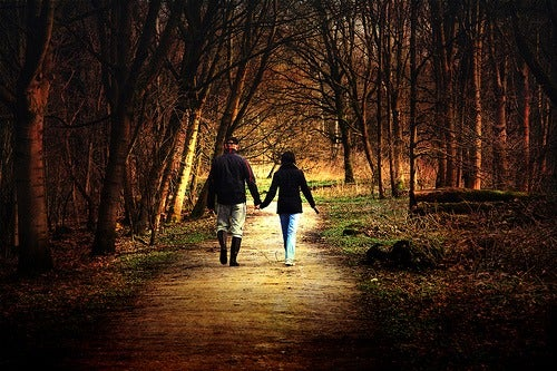Couple walking on a forest trail