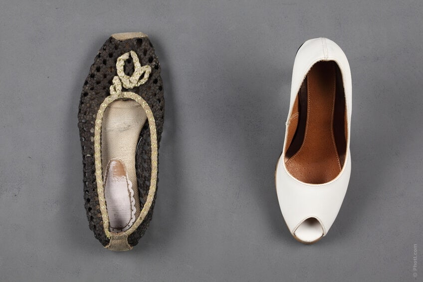 Ballerina flat and high heel next to each other