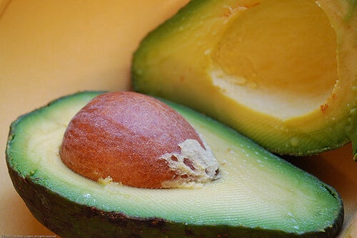 An avocado and its seed.