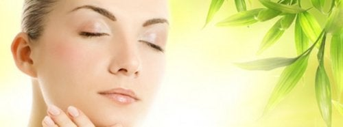 Woman with perfect skin eyes closed glowing skin