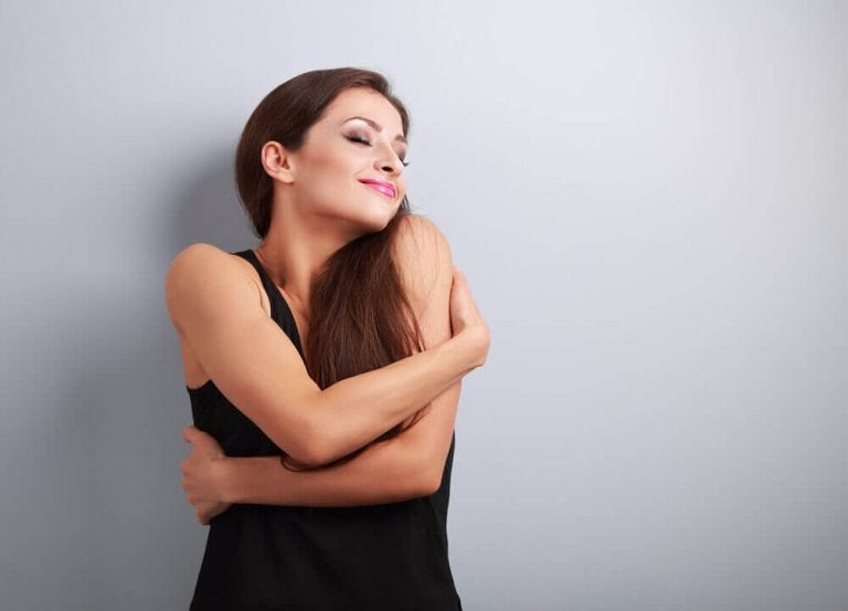 Woman hugging herself