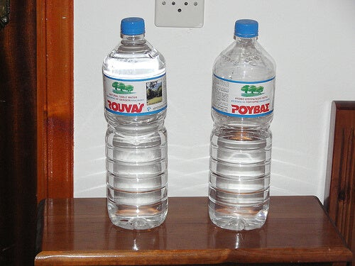 Bottled water sitting on a table