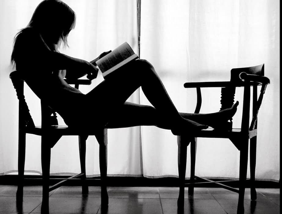 Woman reading in a chair