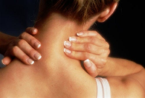 woman rubbing her neck