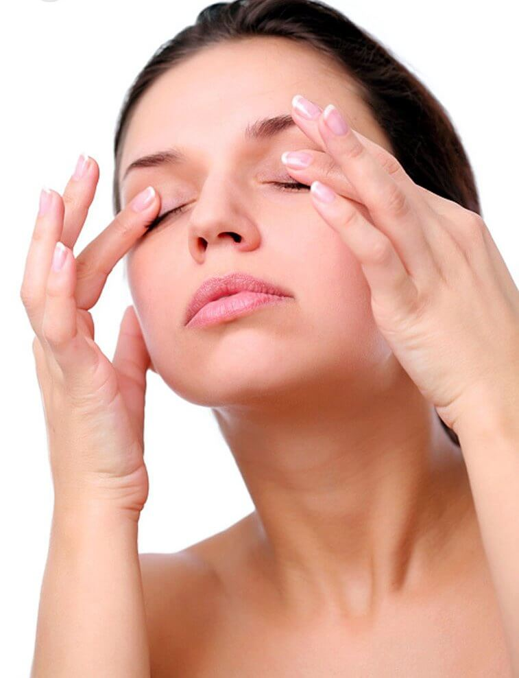 Woman massaging her eyes as a way to rejuvenate your skin