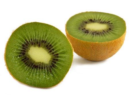 A kiwi fruit cut in two.