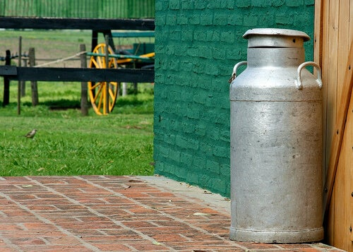 A milk churn on a farm.