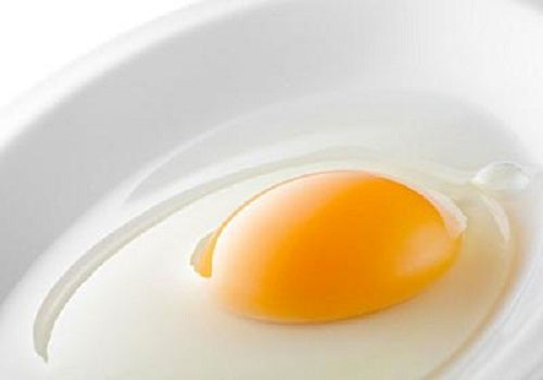 A raw egg in a container.