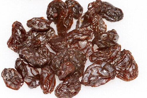 Raisins with a white background benefits of raisins