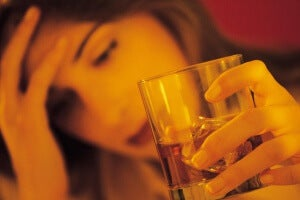 Woman drinking alcohol tired how to strengthen your immune system