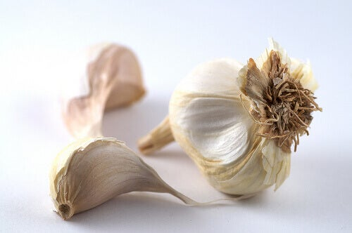 Two garlic cloves and a head of garlic
