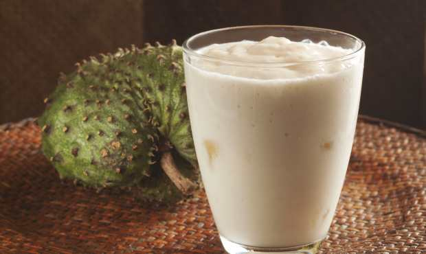 Custard apple or soursop juice with ice