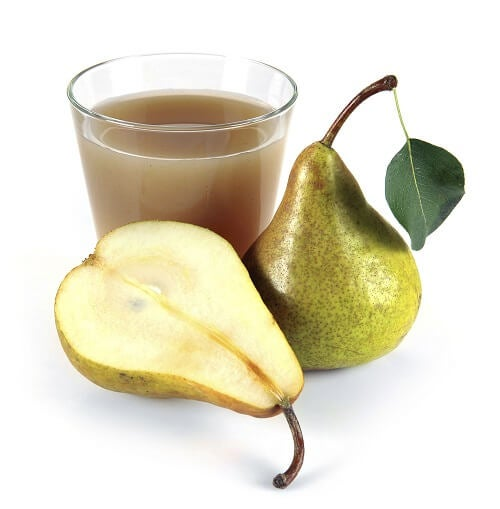 pear juice in a glass of fruit on a white
