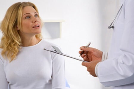 Doctor asking woman questions