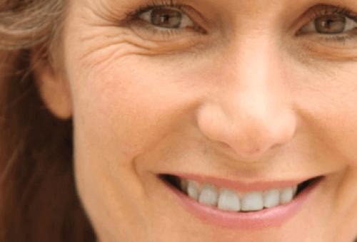 Exercises to tone your face woman's face with wrinkles near eyes
