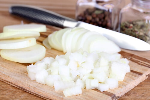 Onions chopped up on a cutting board