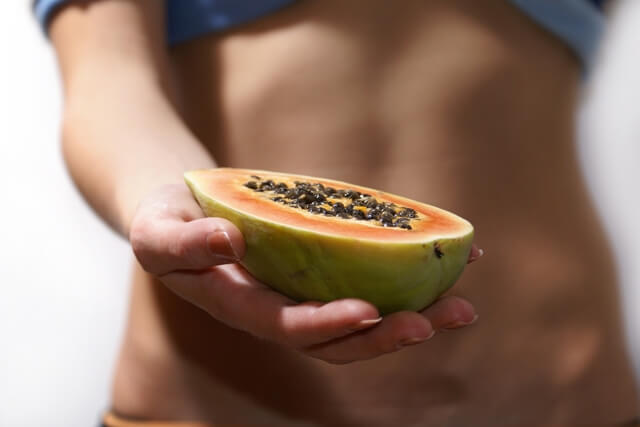 person holding papaya