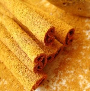 Cinnamon sticks covered in cinnamon powder