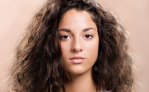 Girl with brown, frizzy hair