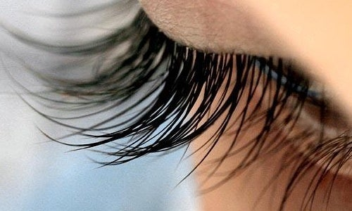 A woman with long eyelashes.