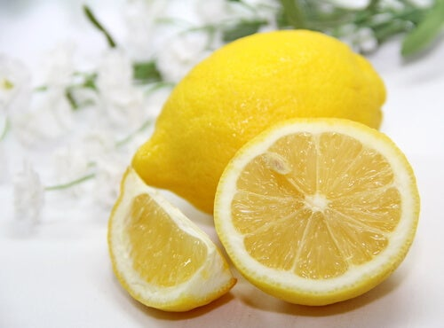 Sliced and whole lemon