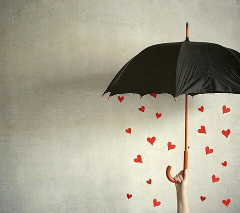 Heart and love rain and an umbrella.