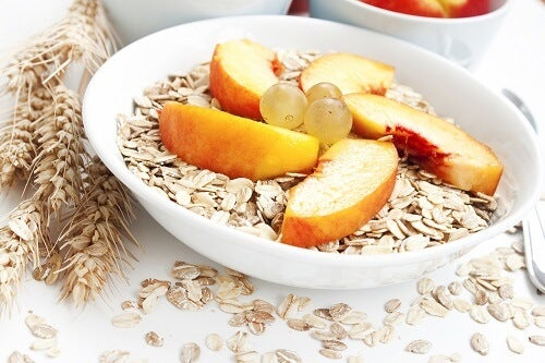 healthy breakfast with peaches,grapes and cereals