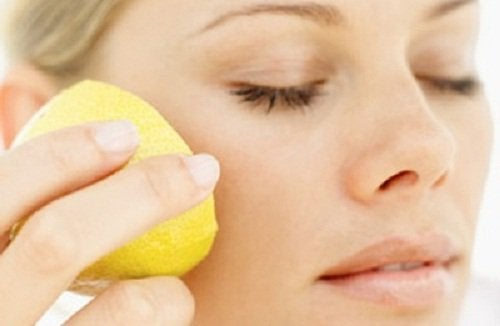 Woman applying lemon to her skin