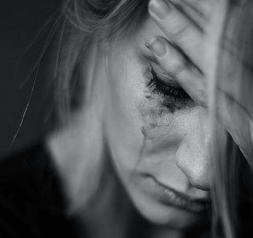 Women in the press of overcoming grief and pain