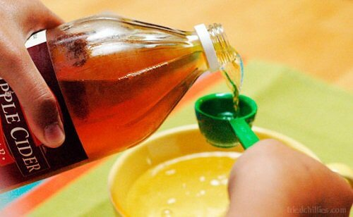 Pouring apple cider vinegar