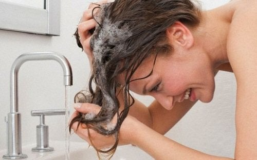 A woman washing her hair.