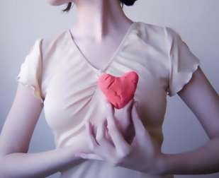 A woman holding her heart.