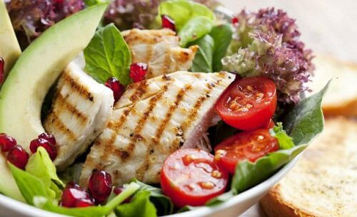 Bowl of salad with a grilled chicken breast