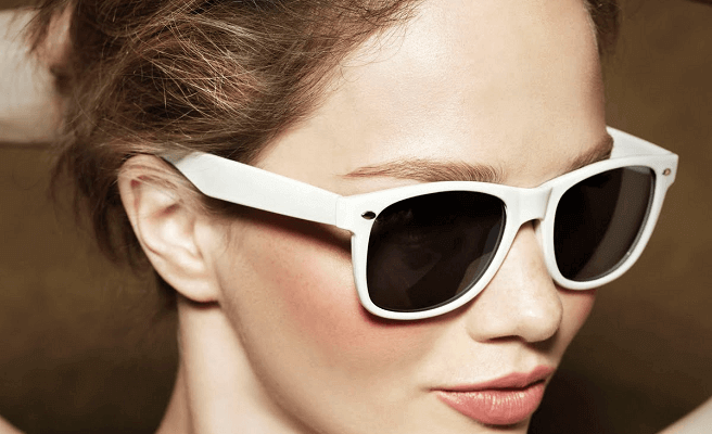 woman wearing white sunglasses, feeling whole