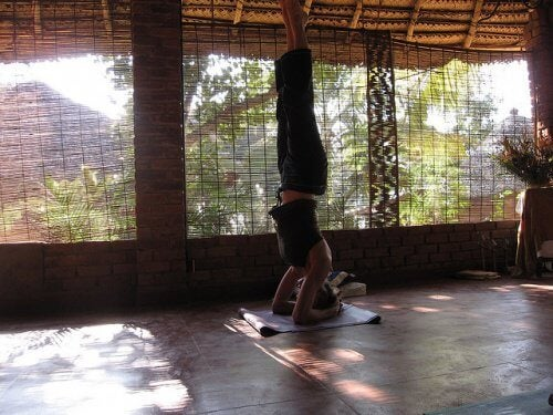A woman doing yoga to improve her circulation and prevent varicose veins
