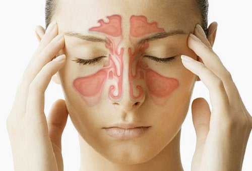 Woman touching her temples to alleviate nasal congestion